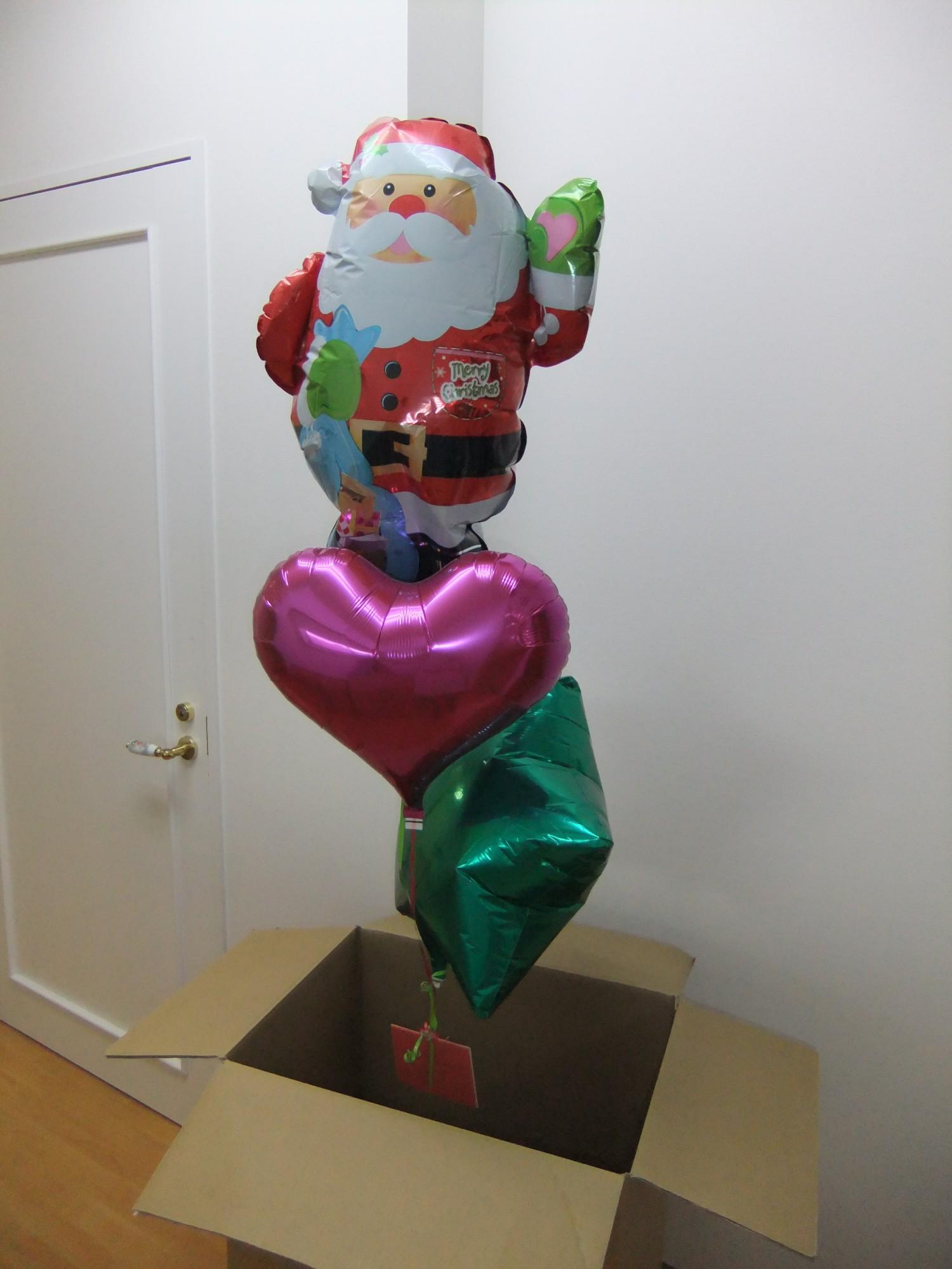 「メリーXmas! 」サンタクロースが大きな箱からポヨっと出てきてごあいさつ♪(箱の大きさ 約75×37×50センチ)